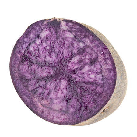 Fresh purple potato isolated on a white background.