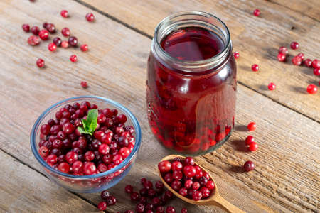 Delicious cranberry juice with whole cranberries. Healthy drink.