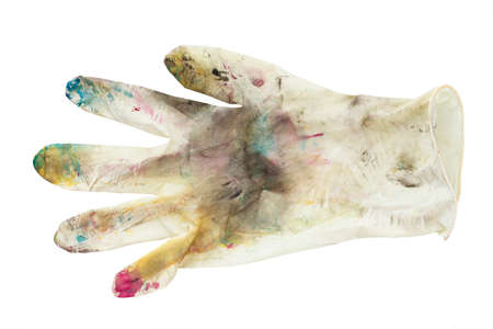 White rubber gloves in spots of paint on white background. The concept of creativity, creation.
