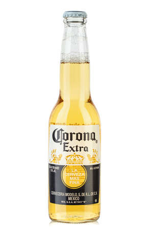 Ukraine, Kyiv - June 03, 2020: Photo of Corona Extra Beer bottle   isolated on white background. Corona Extra is produced in Mexico. File contains clipping path. Editorial