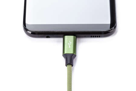 Mobile smart phones charging on white background. Archivio Fotografico