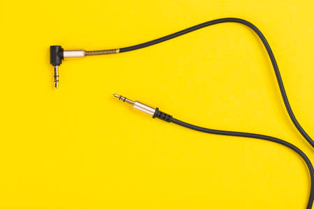 Black jack plug on the yellow background. Top view.