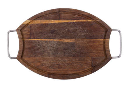 Brown cutting board on a white wooden background. View from above. Place for text.