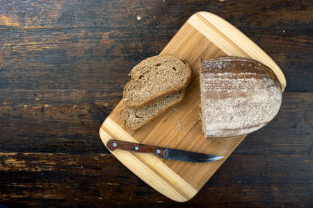 Sliced fresh bread on table close-up. Healthy food and traditional bakery concept.