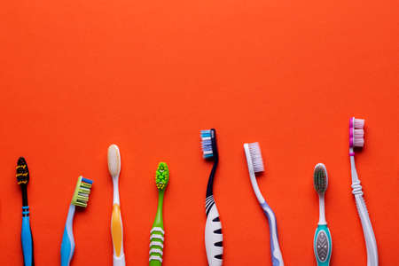 Toothbrush isolated in orange background. Health Care. Stok Fotoğraf