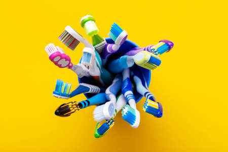 Toothbrush isolated in yellow background. Health Care. Stok Fotoğraf
