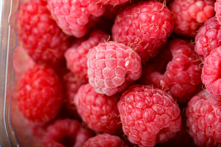 Fresh raspberries in store packaging. Healthy food.