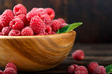 Fresh raspberry in a wooden plate 스톡 콘텐츠