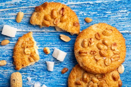 homemade shortbread cookies with peanuts scattered on the table. place for text Reklamní fotografie