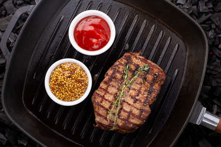 Beef steak on a grill pan. View from above.