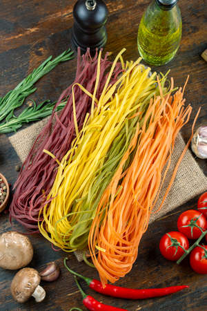 Italian multi colored pasta. Italian food concept. Ingredients for making pasta.