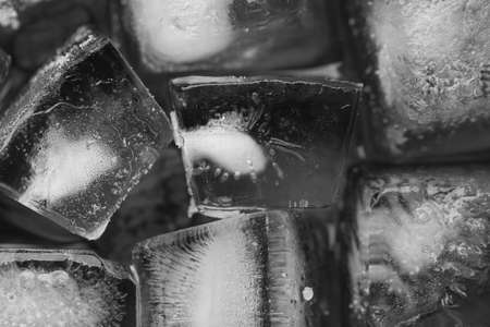 Ice cubes close-up on a black background. View from above.
