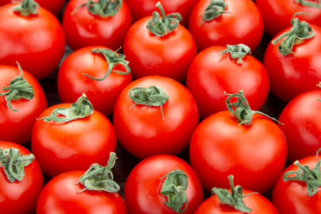 ripe tomatoes as abstract background. close-up. farmer organic crop. place for text
