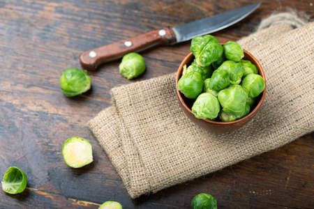 Brussels sprouts on rustic wooden table. Top view