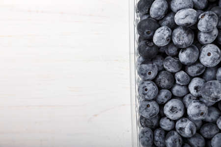 Blueberry antioxidant organic superfood in a plastic container concept for healthy eating and nutrition. Concept for healthy eating and nutrition. Space for text. Top view. Zdjęcie Seryjne