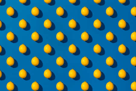 Patterns with fresh lemon on a blue background. Top view