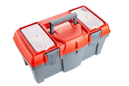 Isolated plastic toolbox with red top on white background. File contains clipping path. Banco de Imagens