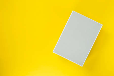 Light box on a yellow background. Space for text. Top view. Banco de Imagens