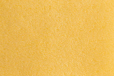Yellow blistered surface. Seamless background.