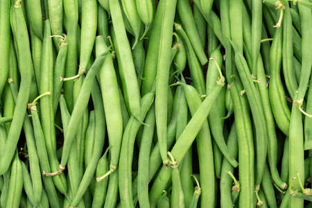 Green beans background. Fresh harvest of healthy vegetables. Top view.