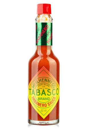 Ukraine, Kyiv - December 08.2020: Image of Tabasco hot sauce in the bottle. Tabasco sauce was started in 1868 and is made from tabasco peppers.
