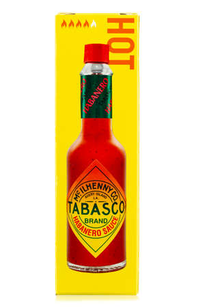 Ukraine, Kyiv - December 01.2020: Tabasco sauce in carton box. Tabasco sauce was started in 1868 and is made from tabasco peppers. 報道画像
