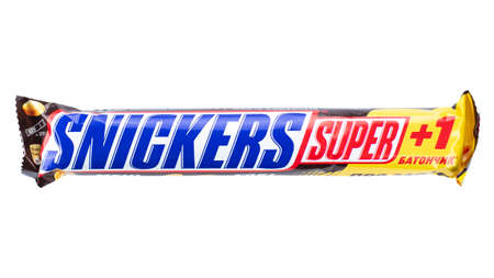 Ukraine, Kyiv - November 30.2020: Snickers Super chocolate bar isolated on white background. Snickers is a brand name chocolate bar made by the American company Mars.