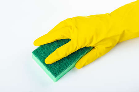 Sponge for washing dishes in hand. Hand in a latex glove isolated on white. Hand gesture or sign isolated on white. Cleanliness and cleaning concept. File contains clipping path.