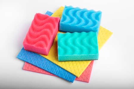 Set of multicolored dishwashing sponges isolated on white background. File contains clipping path.
