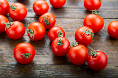 Ripe tomatoes on a wooden background. Harvesting concept. Vegetarian food. 写真素材