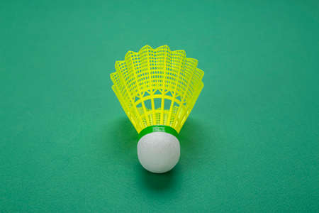 Badminton shuttlecock on a green background. Minimalism. Concept summer entertainment. Sport games. Space for text. 写真素材