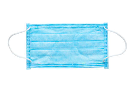 Surgical mask with rubber ear straps on a white background. Typical 3-ply surgical mask to cover the mouth and nose. Procedure mask from bacteria. File contains clipping path. Top view.
