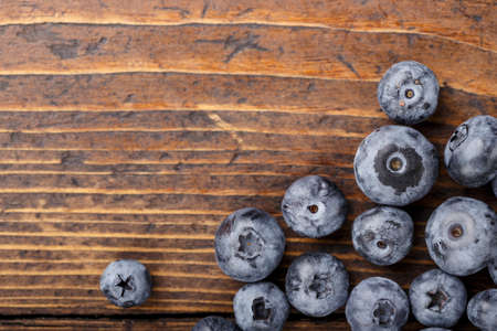 Fresh Blueberry on a wooden table. Various fresh summer berries Concept of healthy and dieting eating. Space for text. Tasty food. 写真素材