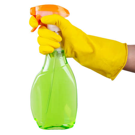 Cleaning concept - woman hand in yellow rubber protective gloves hold cleaning agent bottle isolated on white background. Cleaning Service Worker.