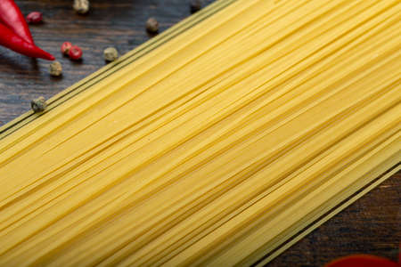 Spaghetti and Ingredients on an old and vintage wooden table. Italian Cuisine. Tasty food. 写真素材