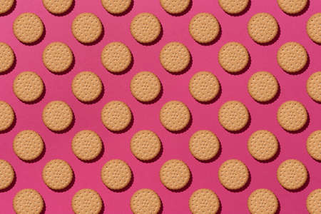 Sweet cookies flat lay pattern on light pink background. Top view.