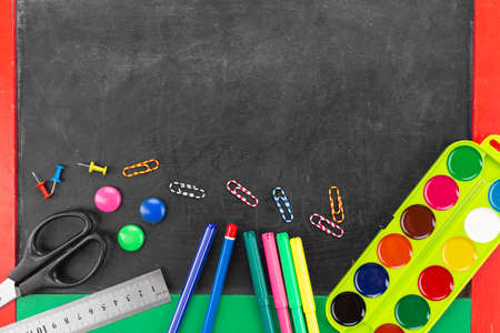 school supplies are scattered on a dark background. Space for text Reklamní fotografie