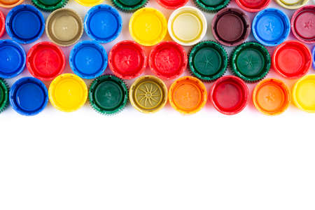 Plastic bottle caps background. Cap material is recyclable. Recycling collection and processing plastic bottle caps. Top view.