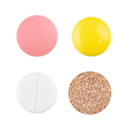 Many colorful pills and tablets isolated on white. Pharmacy drugstore products. Pharmaceutics. Pain relievers. 写真素材