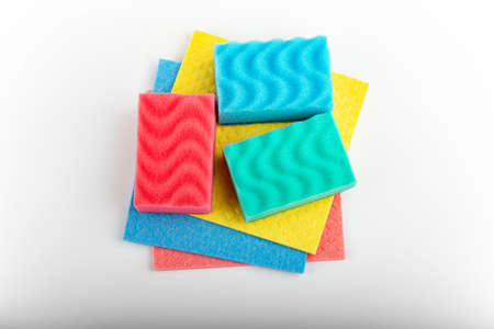 Set of colorful clothes and sponges for cleaning and washing dishes on white background, close up Cleaning sponge. 写真素材