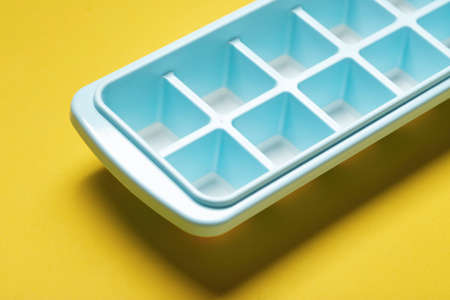 Blue plastic mold for making ice cubes for use in cocktails. Space for text. 写真素材