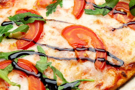 Delicious pizza, which includes tomatoes, cheese, arugula, peppers. Italian cooking. 写真素材