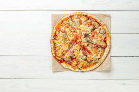 Delicious pizza on white wooden table. Pizza delivery. Pizza menu. Space for text. View from above. 写真素材