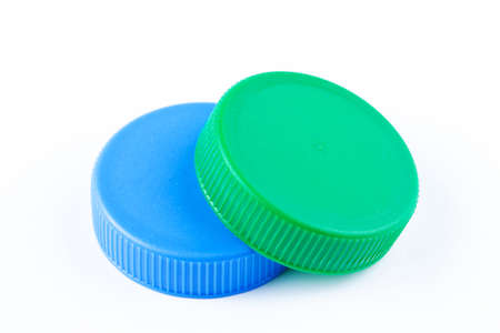 Two plastic bottle cap on white background. Recycling collection and processing plastic bottle caps.