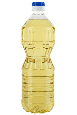 Vegetable or sunflower oil in a plastic bottle isolated with white background. File contains clip path. 写真素材