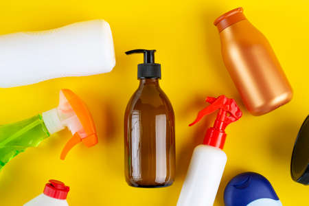 Set of cosmetic containers on a yellow background. Top view. Beauty and personal care concept 写真素材
