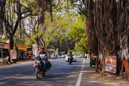 Ellora, Maharashtra, INDIA - JANUARY 15, 2018: Typical road in india. Shady beautiful road in a rural area