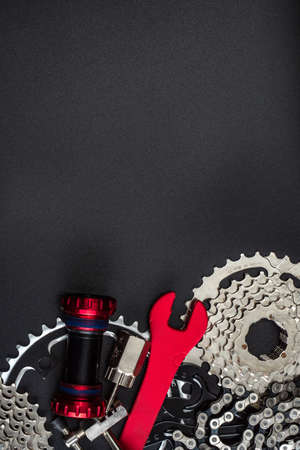Tools for repairing a bicycle on a dark background. Bicycle service. Composition for placing text Imagens