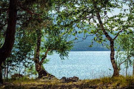 Hot noon on the shore of a mountain lake. Imantau lake. Kazakhstan