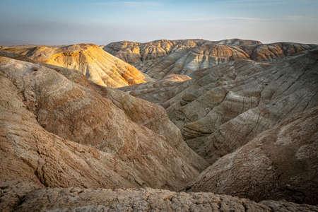 Evening landscape of desert mountains. Fancy Sand Canyons. National Park Altyn-Emel. Kazakhstan